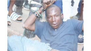 A suspected robber who was part of a six man gang robbed a Bulawayo woman